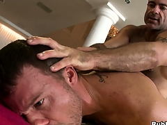 Horny padre bear shacking up a young chunk in a hot hardcore anal gay video