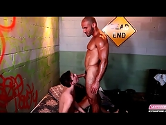 Twink gives blowjob to a muscular guy