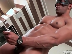 Masturbating threatening guy cums on the top of his abs