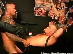 Leather bears anal ramming with a big dildo